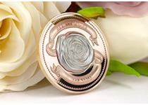This is the All My Love Rose Silver Coin. It features a .999 Fine Silver Centerpiece of a perfectly formed rose, an insert to the coin base minted in almost sculptural high relief.