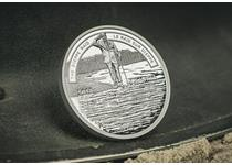 Struck by the Royal Canadian Mint to commemorate the Dieppe Raid. The reverse design depicts a veteran saluting the fallen who appear as a reflection in the water. Obverse: effigy of George VI.