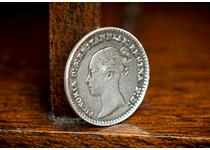 This is an example of a Silver Maundy penny issued during the reign of Queen Victoria. Maundy coins are issued at Easter each year by the reigning monarch.